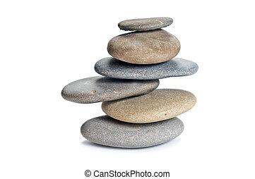 balanced stone tower isolated on white