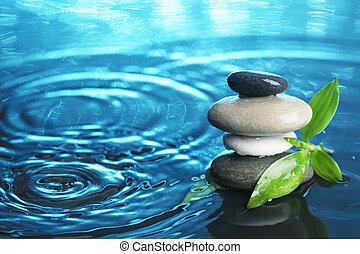 Balanced stones in water