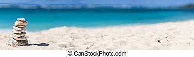 Balanced Stones - Panoramic photo of stack of white corals...