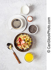Balanced traditional breakfast and ingredients. Whole grain rings cheerios, coffee, orange juice and egg.