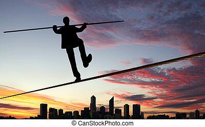 Balancing businessman and cityscape - Business man balancing...