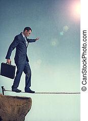 balancing businessman