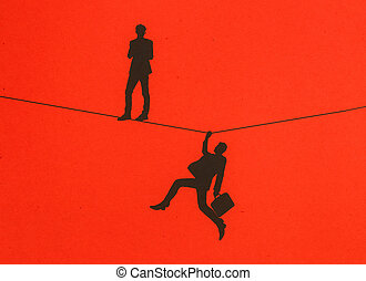 Balancing concept - Men silhouettes standing and holding...