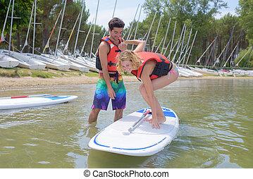 balancing on the paddleboard