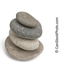 Balancing pebble rocks on white