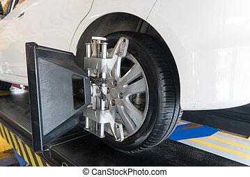 Balancing tire wheel machine Hunter. Tyre assembling. Tire...