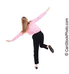Balancing young business woman. or dodge falling woman. Rear...