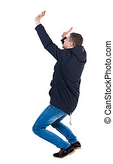 Balancing young man in parka.