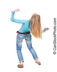 Balancing young woman. or dodge falling woman. Rear view...
