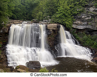 Blackwater Falls, West Virginia waterfall shot with silky smooth blurred water effect.
