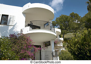 Balconies of Residential building at Mediterranean place with pines