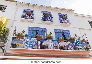 balconies with flamenco dresses in Marbella, Andalucia Spain