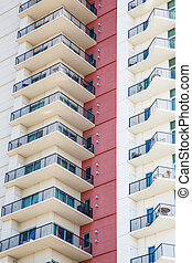 Balconies with Wrought Iron Railings by Red Wall