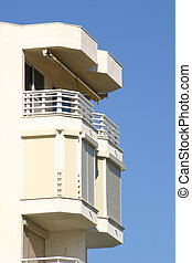 balcony against a blue sky
