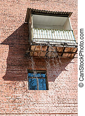 Balcony and window on the brick wall