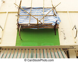 balcony construction with scaffolding on old building