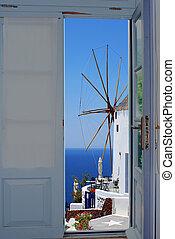Balcony door with a great view on Santorini island, Greece