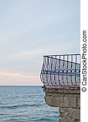 Balcony fence in front of the sea in Sitges, Spain - Balcony...