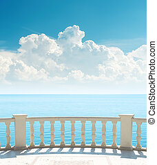 balcony near sea and clouds over it