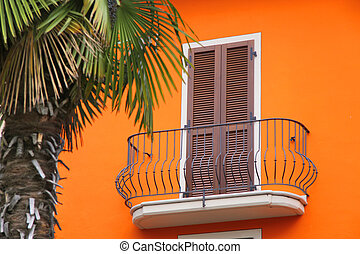 Balcony of a house with an orange facade