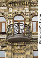 balcony on a brick building