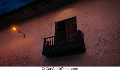 Balcony On Side Of Building In The Evening - Wooden balcony...