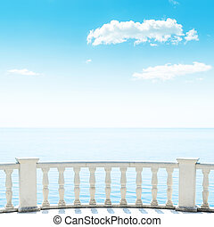 balcony over sea and white clouds in blue sky