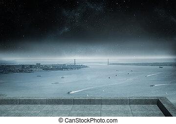 Balcony overlooking coastline at night