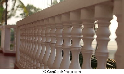 balcony rail close to the beach background and palm trees in...