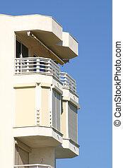 balcony against a blue sky