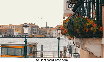 Balcony with flowers on the background of Venice, Italy -...