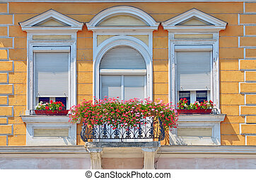 balcony with flowers pots in summer time