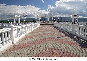 Balcony with white columns.