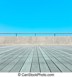 Balcony, Wooden plank floor, concrete fence and blue sky. Outdoor architecture, bottom perspective