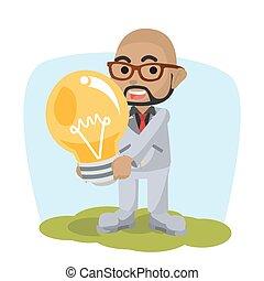 bald african Men holding giant bulb