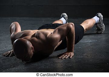 Bald athlete with a beautiful body and naked torso