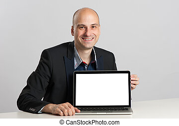 bald businessman and laptop with copy space