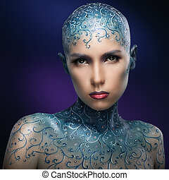 Bald girl with colorful make-up art.