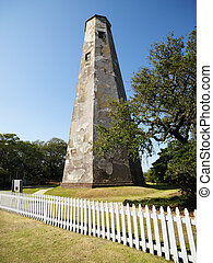 Bald Head Lighthouse in North Carolina with picket fence.