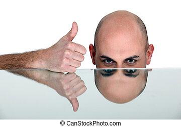 Bald man giving thumbs-up