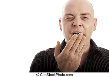 bald man on white background is tired and yawn