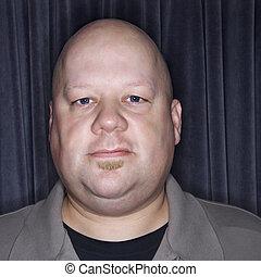 Bald man portrait.