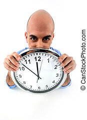 Bald man showing a clock