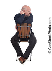 bald man sitting on white background, look side