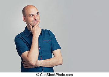 bald man thinking and looking side