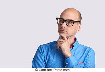 Bald man thinking isolated