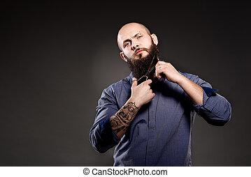 Bald man with a beard cut off his beard