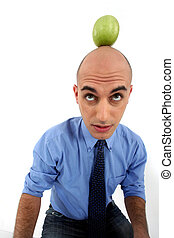 Bald man with apple on the head