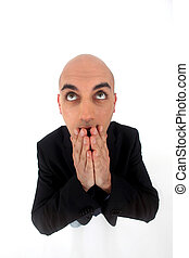 Bald man with expression of surprise on white background