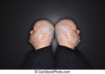 Bald twin men. - Caucasian mid adult identical twin bald men...
